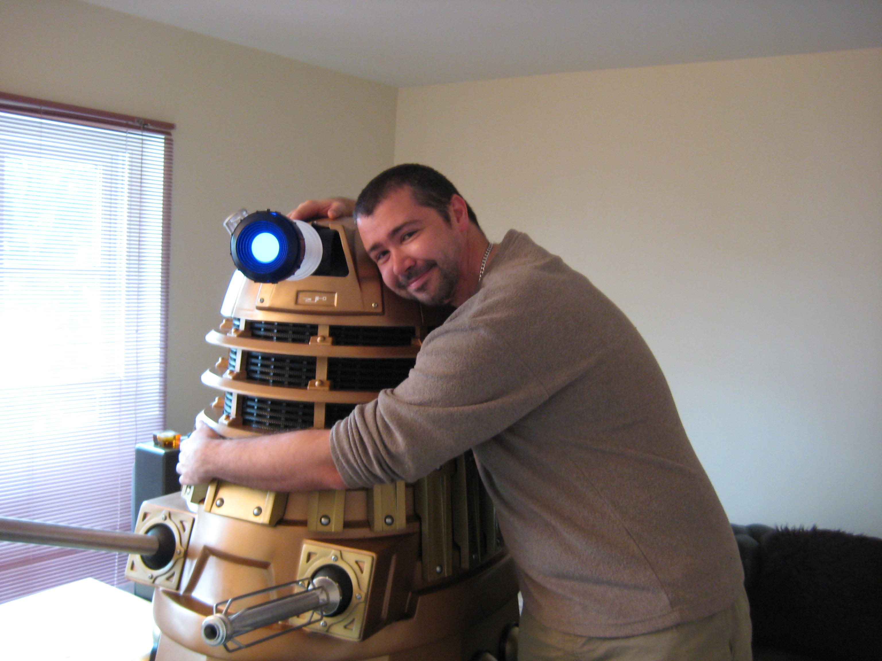 man hugging Dalek in the WRONG way!